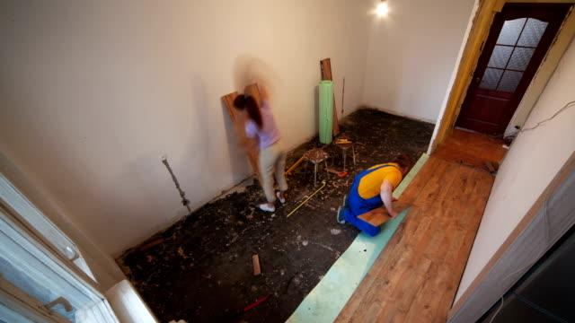 renovated apartment. laying laminate flooring