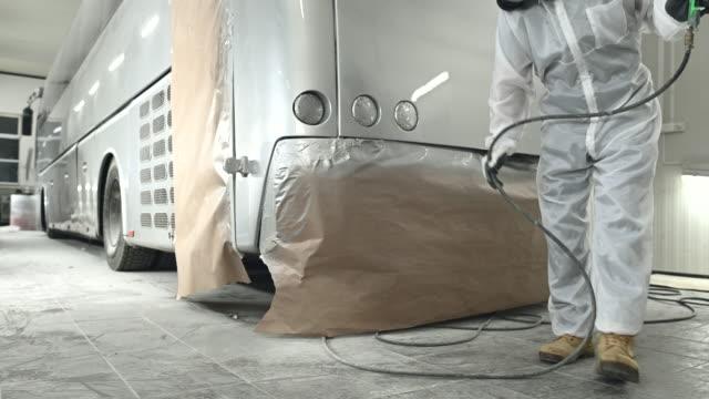 Repainting Commercial Bus In Bodyshop Garage.