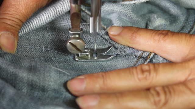Repair denim with sewing machines. video