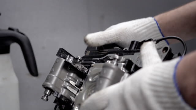 Repair Element of Automatic Car Transmission at Workshop video