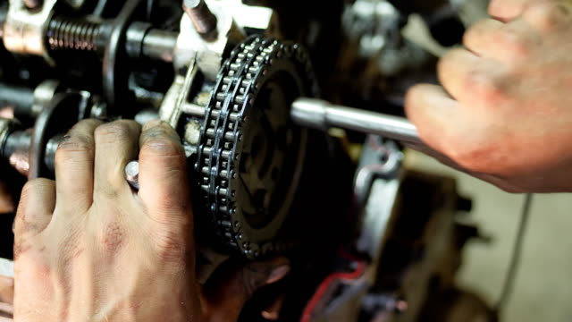 Repair old car engine Auto mechanic is using wrench and spinning bolts inside a used car engine, extracted from automobile. Close-up wrench stock videos & royalty-free footage