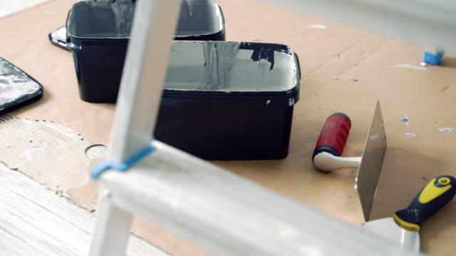 Repair. Paint, working tools, spatulas on cardboard.