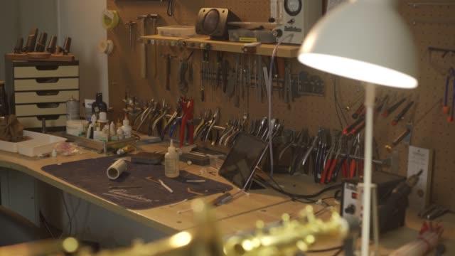 repairing saxophone music wind instrument workshop studio