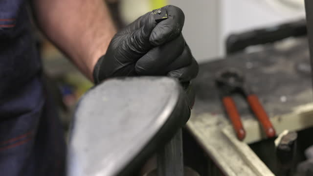 Repairing shoe high heel tip, gluing on and nailing with hammer, small business workshop