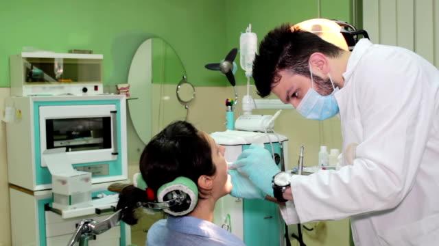 Repairing teeth in dental clinic video