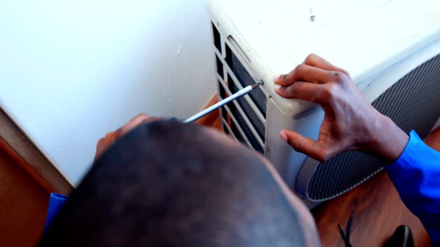 Repairman fixing air conditioning video
