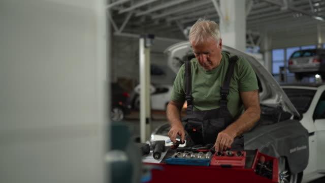 Repairman working at auto repair shop