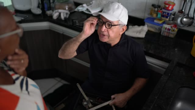 Repairman working at customer's home Repairman working at customer's home pipefitter videos stock videos & royalty-free footage