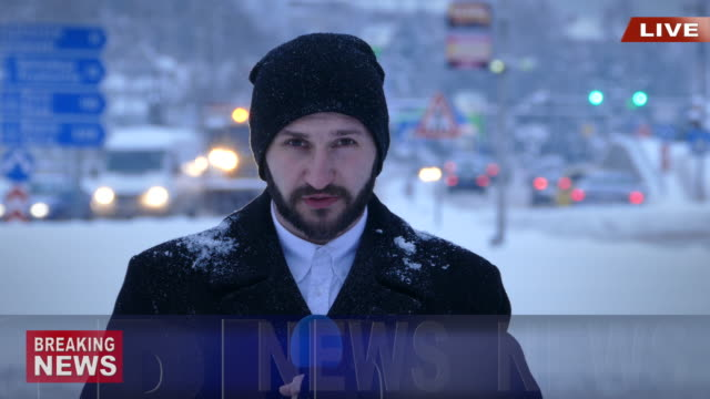 TV reporter presenting actual snow situation in town video