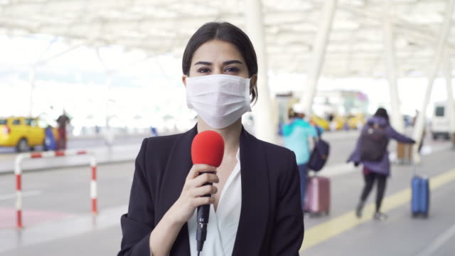 TV reporter wearing a mask TV reporter wearing a mask. journalist stock videos & royalty-free footage