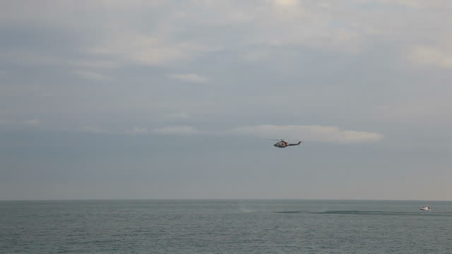 Rescue helicopter hovering over sea  medevac stock videos & royalty-free footage