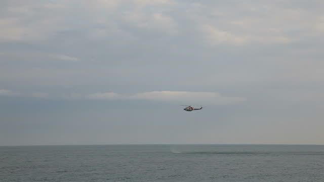 Rescue helicopter hovering over sea ( Timelapse)  medevac stock videos & royalty-free footage