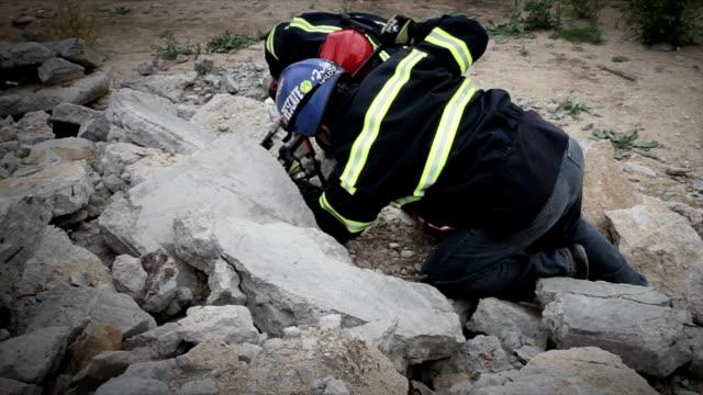 Rescue team over the rubbles