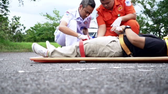 Rescue Emergency medical technicians holding a wounded person physical injury stock videos & royalty-free footage