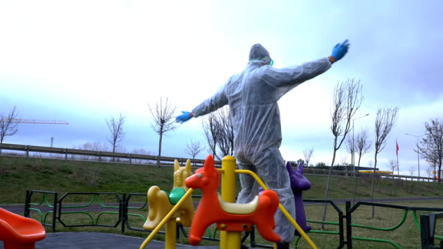 Researcher in Playground with Protective Outfit on Outdoor