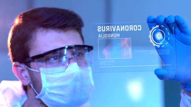 Researcher Looking at Coronavirus Results. Mongolian Flag on Digital Screen in Laboratory