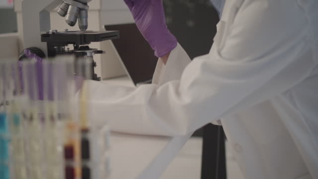 Researcher Using Microscope In Her Lab. video