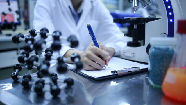 Researchers working in laboratory video