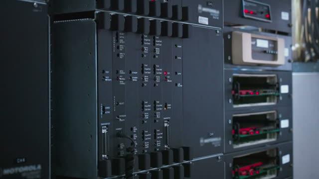 Reset TRUNK Radio network in network room Reset TRUNK Radio network in network room mainframe stock videos & royalty-free footage