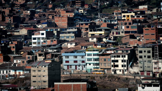 residential area in developing country on sunny day - argentyna filmów i materiałów b-roll
