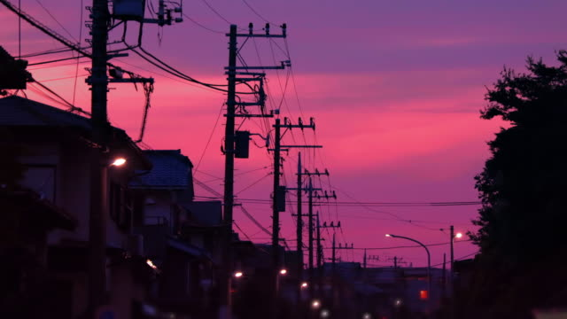 A residential area in the suburbs of Yokohama that is dyed by the sunset A residential area in the suburbs of Yokohama that is dyed by the sunset sunset to night time lapse stock videos & royalty-free footage