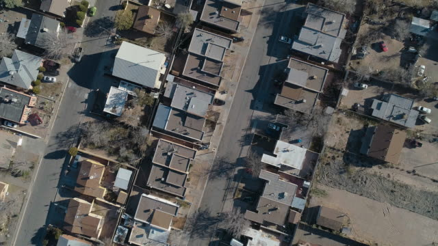 Residential district of Albuquerque, New Mexico, on a sunny day in late November. Aerial drone video with the panning camera motion.