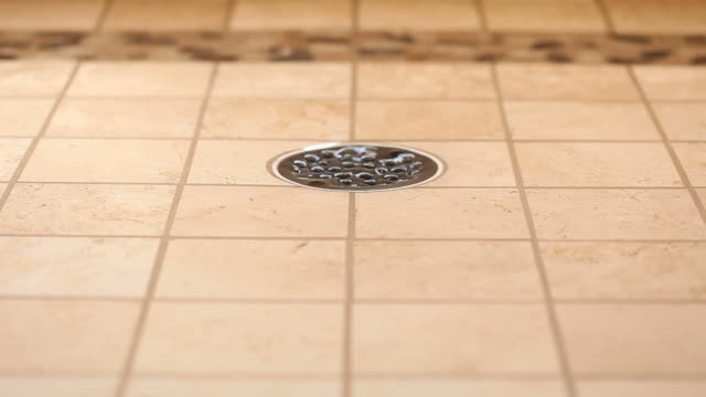 Residential Tiled Shower Drain with Running Water which Stops video