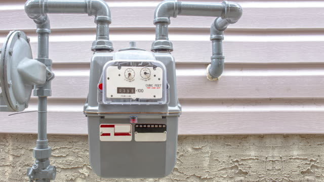 Residential urban natural gas meter, measuring gas consumption, outside house gas meter.