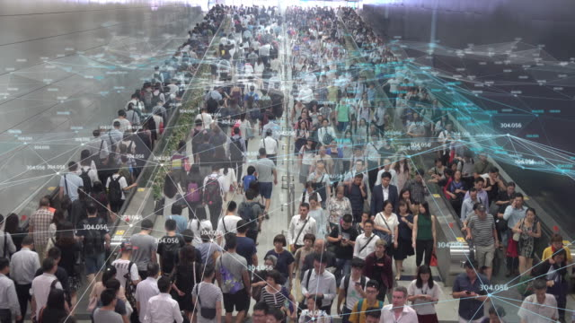 4k resolution networking connection and communication concept with crowd commuters of pedestrian commuters on train station at hong kong station.internet of thing and big data concept - zatłoczony filmów i materiałów b-roll