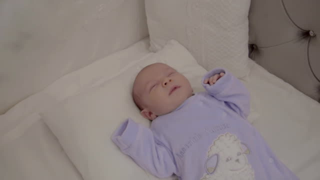4K Resolution - Sleeping baby at home, slow motion