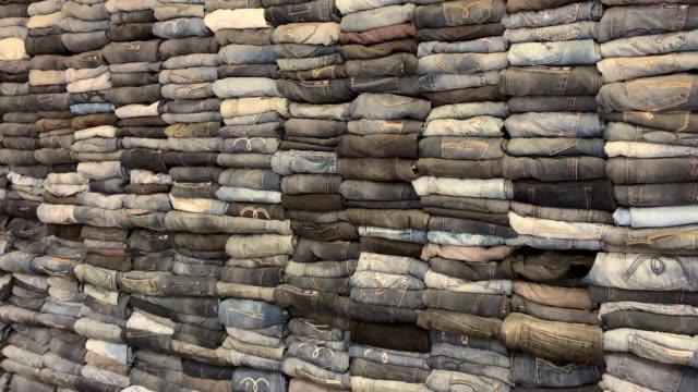 4K Resolution Stack of jeans, Denim background 4K Resolution Stack of jeans, Denim background heap stock videos & royalty-free footage