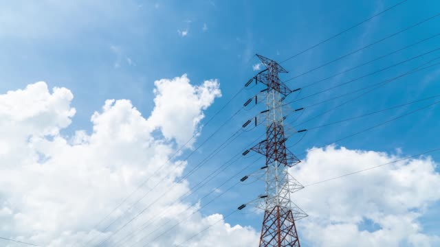 4K Resolution, Time lapse of transmission tower beautiful blue sky and clouds in the background. High Voltage power.