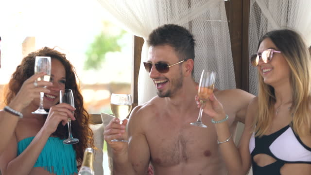 resort Young people are drinking champagne in luxury resort hotel russian ethnicity stock videos & royalty-free footage