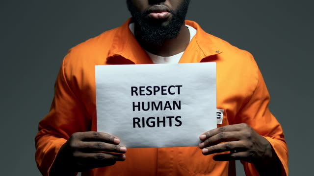 Respect human rights phrase on cardboard in hands of Afro-American prisoner Respect human rights phrase on cardboard in hands of Afro-American prisoner civil rights stock videos & royalty-free footage