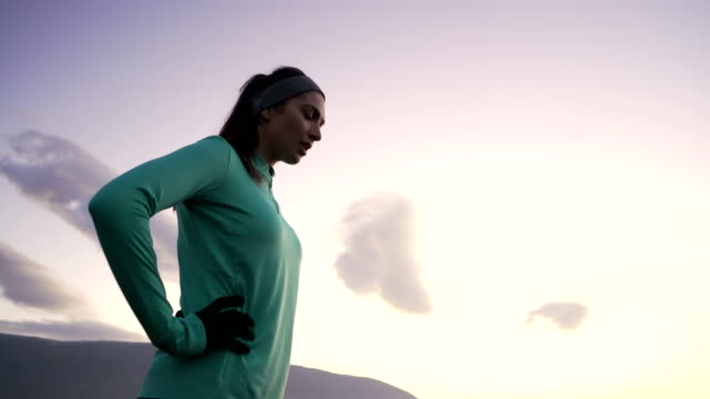 Rest A While Than Run A Mile Beautiful young woman resting after jogging. exhaustion stock videos & royalty-free footage