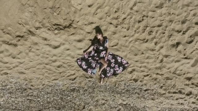 rest on the beach. attractive young woman. aerial view. - prom fashion stock videos and b-roll footage