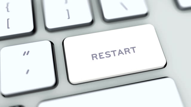Restart button on computer keyboard. Key is pressed. User presses keypad with icon symbol, camera pan, different graphics on keyboard available for download. Using computers contemporary technology, browsing internet pushing buttons. video