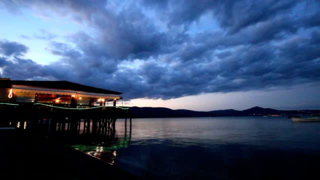 Restaurant on the sea at dusk timelapse video