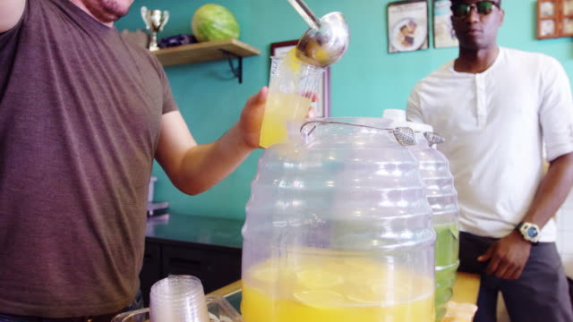 Restaurant Worker Serving Agua Fresca video