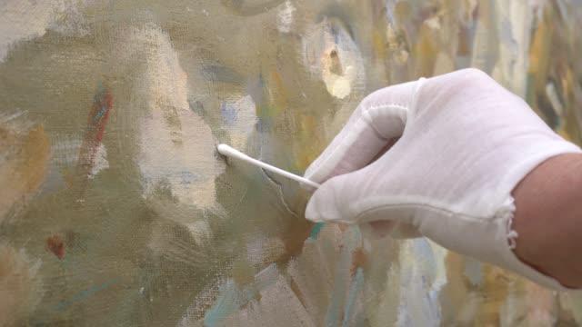 restoration of painting - asta oggetto creato dall'uomo video stock e b–roll