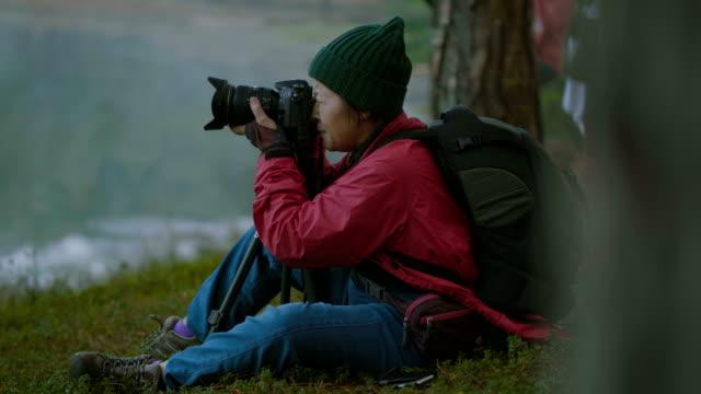 retire activity senior women photographing - woman portrait forest video stock e b–roll