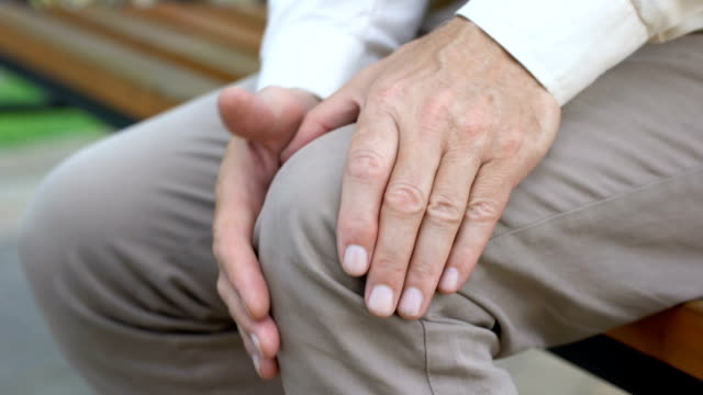 Retired man hardly getting up from bench, pain in joints, problems with knees Retired man hardly getting up from bench, pain in joints, problems with knees pain stock videos & royalty-free footage