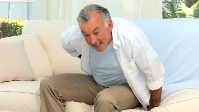 Retired man having a back pain video