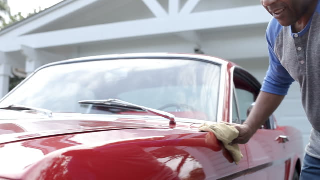 Retired Senior Man Cleaning Restored Car In Slow Motion video