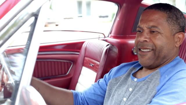 Retired Senior Man Starting Engine Of Restored Classic Car video