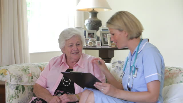 Retired Senior Woman Having Health Check With Nurse At Home video