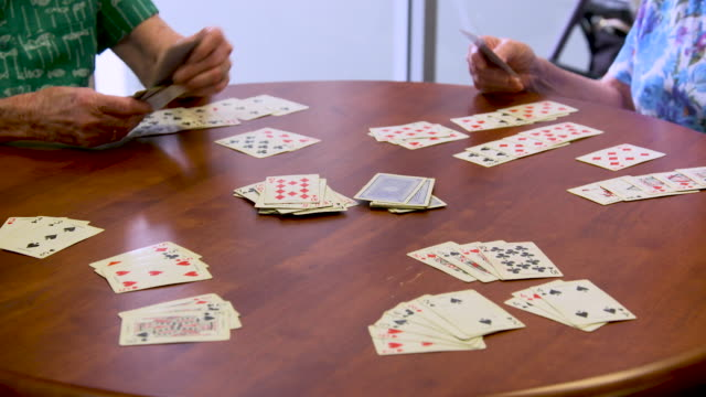 Retired seniors playing cards
