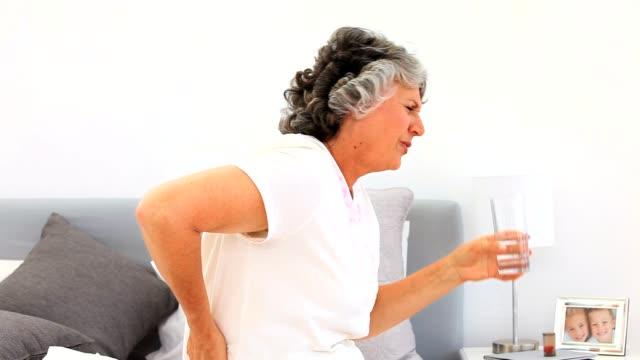Retired woman taking pills video