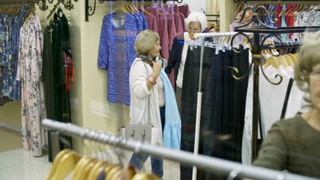 Retired Women Searching for Clothes in Shop video