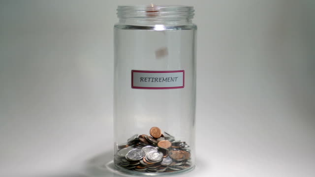 retirement savings jar filled with coins - retirement stock videos and b-roll footage